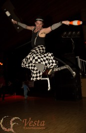 Vesta performer leaps very high on stilts