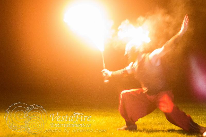 Vestafire performer with sword and fire helmet
