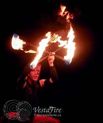 Fire performer with double staff in Victoria