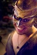 fire dancer in mardigras mask