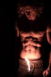 fire performer with nice abs