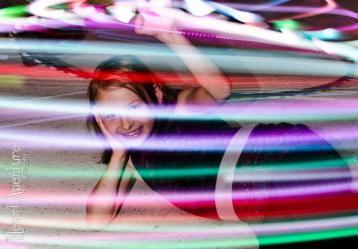 Young VestaFire performer hula hoops