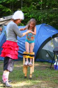Circus perfomer teaches child stilting in Victoria