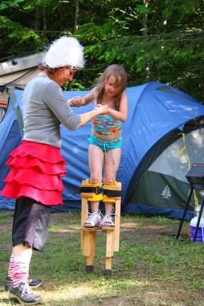Circus perfomer teaches child stilting in Victoria