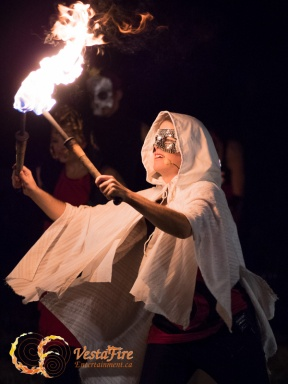 Fire performer dances with fire