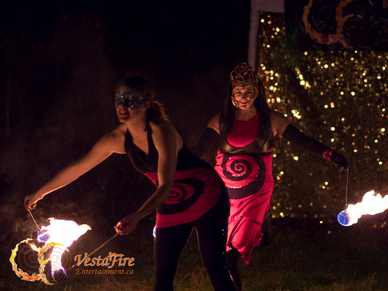 Fire performers dance with Fire poi at halloween show in Nanaimo