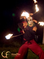 Halloween fire show with skull mask