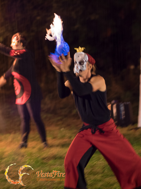 Fire circus performance with halloween mask