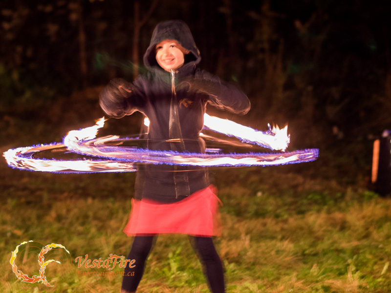 Young fire performer with Fire Hula Hoop in Nanaimo