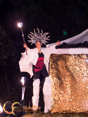 Fire Performer Stilt walker with mirrored headdress in Lantzville