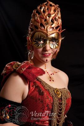 Fire performer in sun goddess costume in Nanaimo